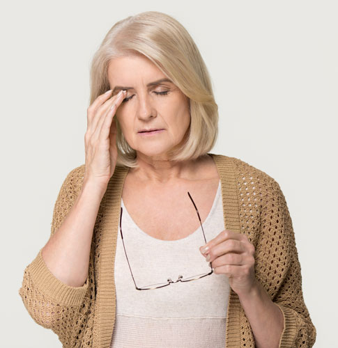 Lady showing signs of Headache